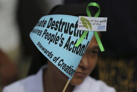 A Filipino nun joins the Climate Solidarity prayer march in Manila, Philippines, November 2015.