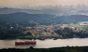 The Panama Canal, with the high-rises of Panama City's San Francisco district in the background.