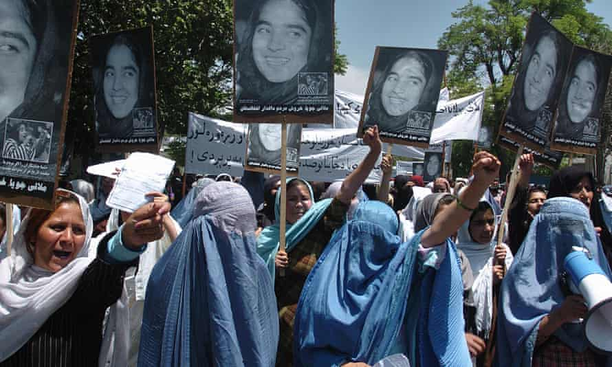 Afghan women shout slogans during a demonstration after Malalai Joya was removed from office
