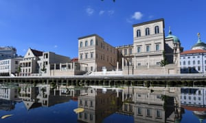 The future art museum Museum Barberini is reflected with other buildings in the Alte Fahrt in Potsdam, Germany.