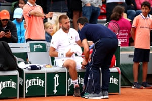 Dan Evans receives treatment.