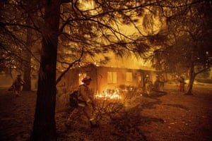Firefighters work to keep flames from spreading through Paradise, California, last week.
