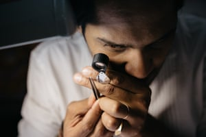Akshat Ghiya checking the clarity of a batch of diamonds at his workshop-store Tallin, in Jaipur.