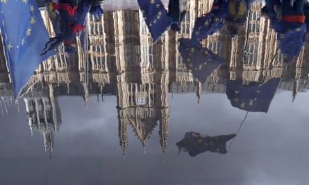 Brexit protesters reflected in a puddle outside parliament on Monday.