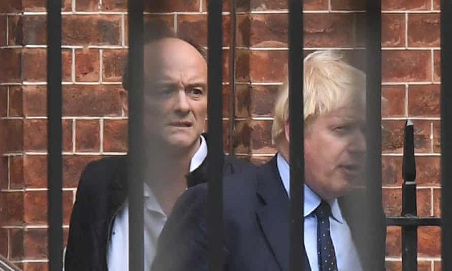 Dominic Cummings, left, pictured through railings, with Boris Johnson in 2019.