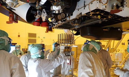 Engineers and technicians insert 39 sample tubes into the belly of the Mars rover Kennedy Space Center, Florida, May 2020.