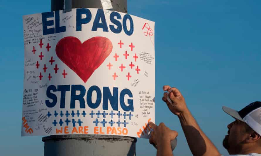 A sign at a makeshift memorial for victims following the shooting in El Paso, Texas, on 6 August.