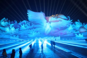 Visitors attend a 3D light show at the Harbin Sun Island International Snow Sculpture Art Expo in Harbin, Heilongjiang province, China January 1, 2018. Picture taken January 1, 2018.
