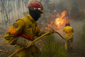 Chaveira, PortugalFirefighters try to extinguish a wildfire at the village near Macao. More than 1,000 firefighters are battling a major wildfire amid scorching temperatures in Portugal, where forest blazes wreak destruction every summer.