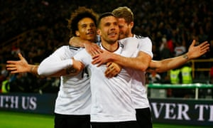 Lukas Podolski is congratulated by Leroy Sané and Andre Schürrle after scoring Germany's winner against England.