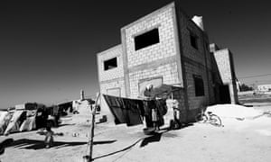 The unfinished house where Raja and Yasser live, near the city of Irbid.