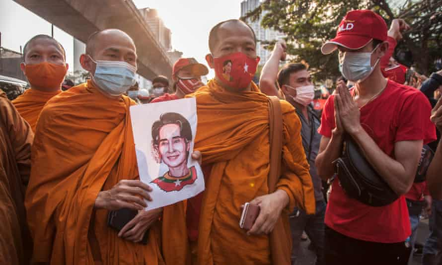 Thai monks hold a portrait of Aung San Suu Kyi during a demonstration against Myanmar's military coup in Bangkok