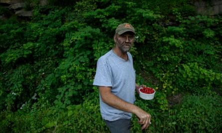 Chuck Denton, 52, picks raspberries after a shift at the coalmine.