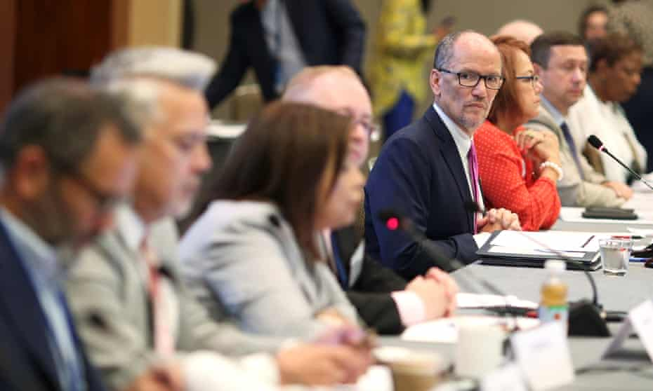 Tom Perez listens to a speaker as he chairs an executive committee meeting in Chicago.