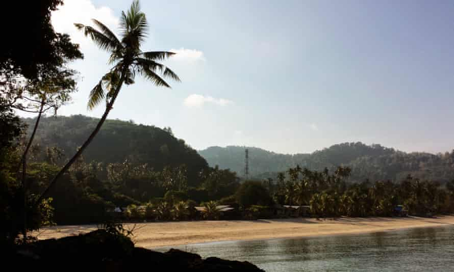 Sandy beach and mountain backdrop at Tioman Island, Malaysia.