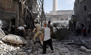 Civil Defence members and Syrians work after the airstrikes.
