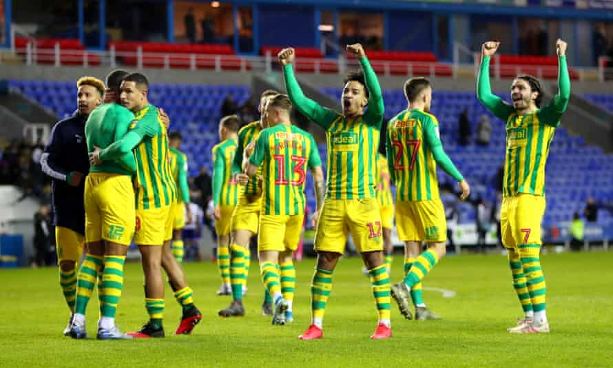 West Brom players celebrate victory after the final whistle at the Madejski Stadium.