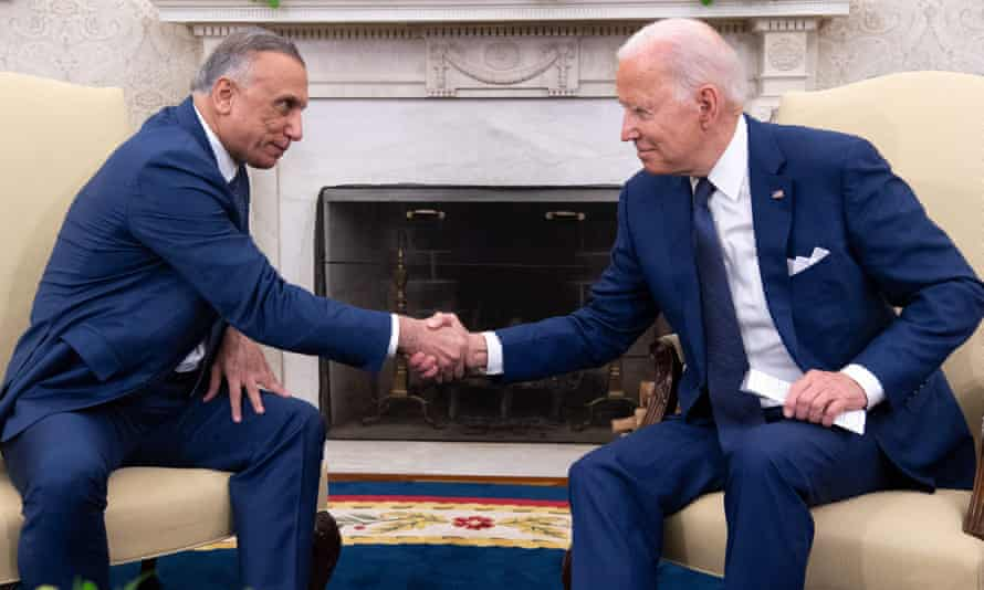 Biden and Khadimi at the White House on Monday. 'We're not going to be, by the end of the year, in a combat mission,' Biden said.