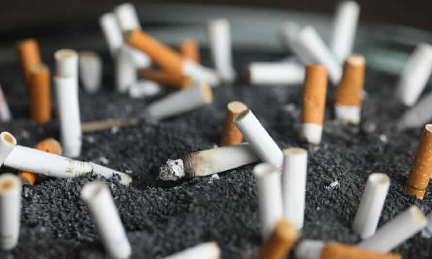 FILE - This March 28, 2019 photo shows cigarette butts in an ashtray in New York. On Tuesday, March 9, 2021. Lung cancer is the nation's top cancer killer, causing more than 135,000 deaths each year. Smoking is the chief cause and quitting the best protection. (AP Photo/Jenny Kane, File)