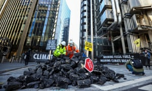 Environmental activists protest outside the Lloyd's building in London.