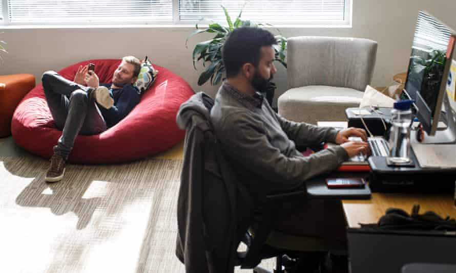 People work in the office of NGIN, a co-working space, in Cambridge, Massachusetts