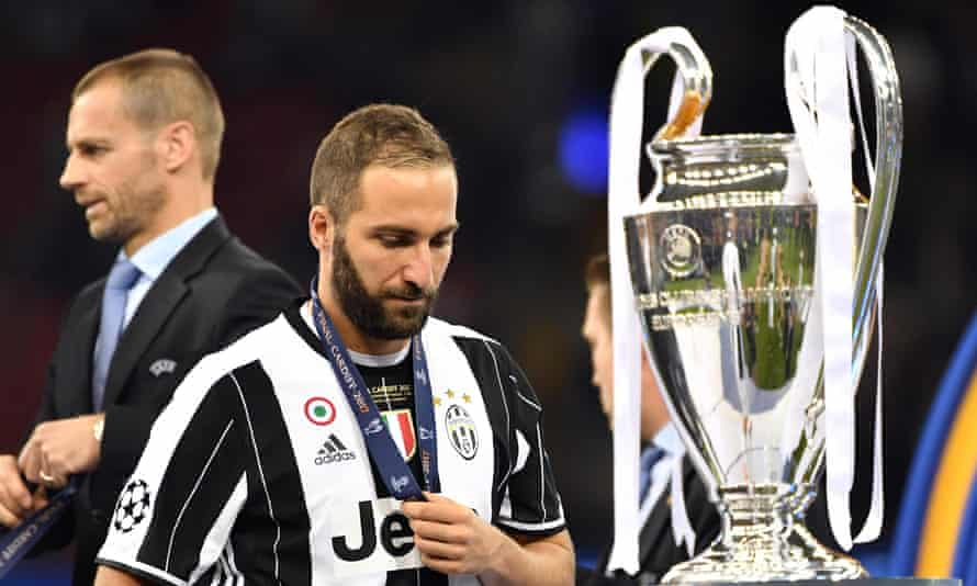 Higuaín has to walk past the Champions League trophy after his Juventus side were beaten 4-1 in the final by Real Madrid in June.