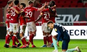 Bristol City's players celebrate Famara Diedhio's late winner against Derby County at Ashton Gate