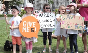 Children and parents demonstrate in Westminster