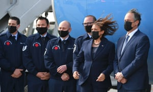 Vice President Kamala Harris and husband Doug Emhoff pose with the The United States Air Force Special Air Mission crew in front of Air Force Two upon arrival at windy LAX Los Angeles International Airport yesterday.