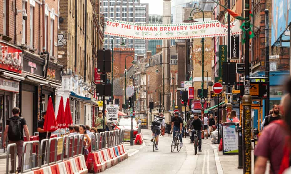 A banner against the redevelopment of the Truman Brewery hangs over Brick Lane.