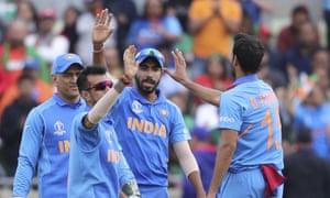 India's Bhuvneshwar Kumar, right, celebrates after the dismissal of Bangladesh's captain Mashrafe Mortaza.