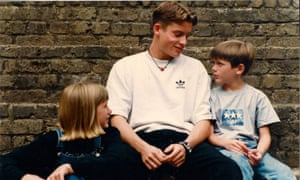 Adam with his brother Neil and sister Holly in London in 1995.