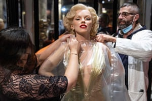 Workers clean Marilyn Monroe's waxwork at the Grévin wax museum ahead of its reopening