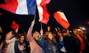 Supporters of Macron celebrating in Paris on Sunday night