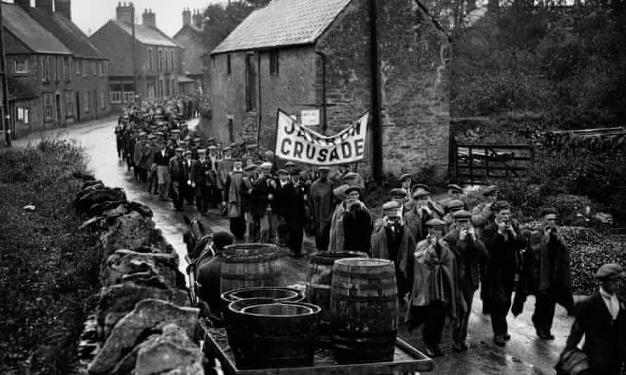 Jarrow marchers passing through a village on their way to London in 1936