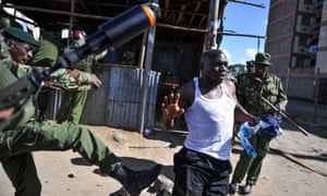 Police clash with an opposition supporter