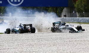 Lewis Hamilton collides with team-mate Nico Rosberg on the first lap of the Spanish GP.