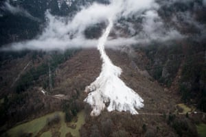 An avalanche flows down below the snow line. Alpine resorts are heading for record snow falls this winter. Gurtnellen, Switzerland