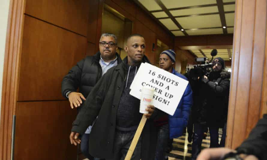 Protesters, angry over Chicago police shootings, try to disrupt Mayor Rahm Emanuel's annual breakfast honoring Martin Luther King Jr on Friday.