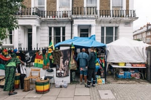Ama (far left) sells flags, clothing, T-shirts and more at one of the nearest stalls to Notting Hill Gate.