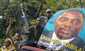 Joseph Kabila supporters parade the president's image through Kinshasa