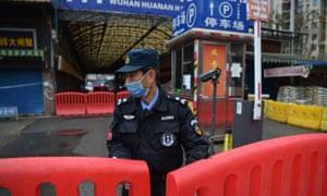 Officer guarding Huanan market