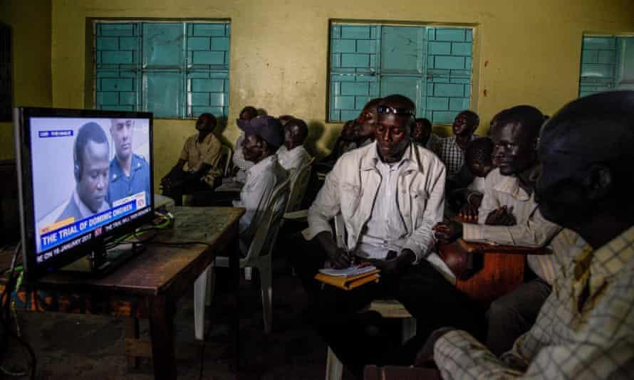 People in Lukodi, Uganda watch the screening of the ICC trial of Dominic Ongwen.