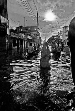 A woman wades through flood waters in Dhaka, Bangladesh, 1988
