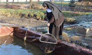 Sister Stefania at her fish pond
