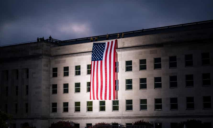 The US national flag is draped over the Pentagon building ahead of a 9/11 anniversary. Democrats have criticised Trump's firing defence staff during a presidential transition.