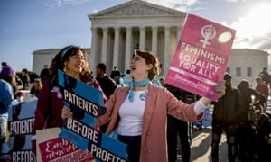 Activists rally before the supreme court in Washington on Wednesday.
