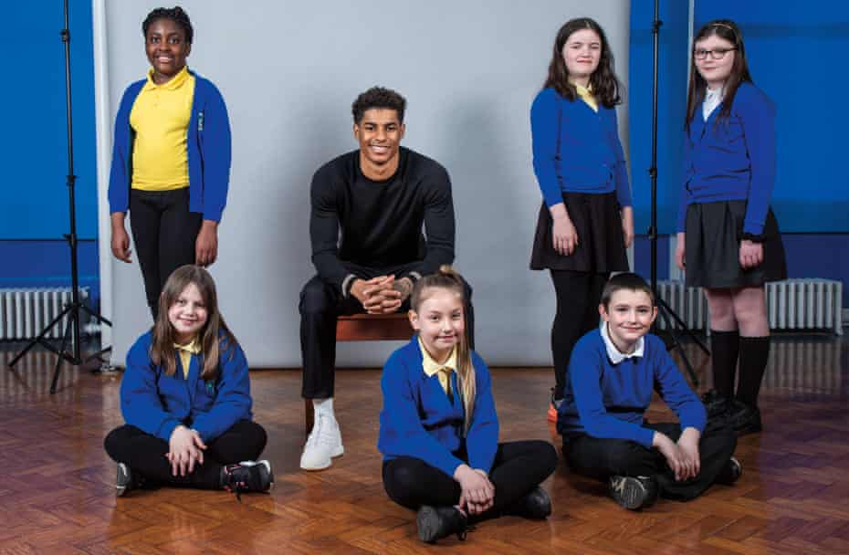 Marcus Rashford with pupils at his former primary school