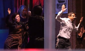 Hostages flee the Lindt cafe at the end of the Sydney siege