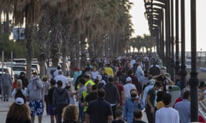 People walk and exercise at Beirut's seaside promenade, taking advantage of warm spring weather after weeks of lockdown.